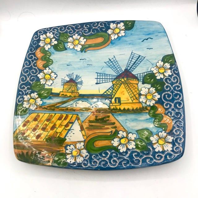 This is a stunning painted Terra Cotta platter from Trapani in Sicily, Italy. It shows the famous windmills of trapani. It...