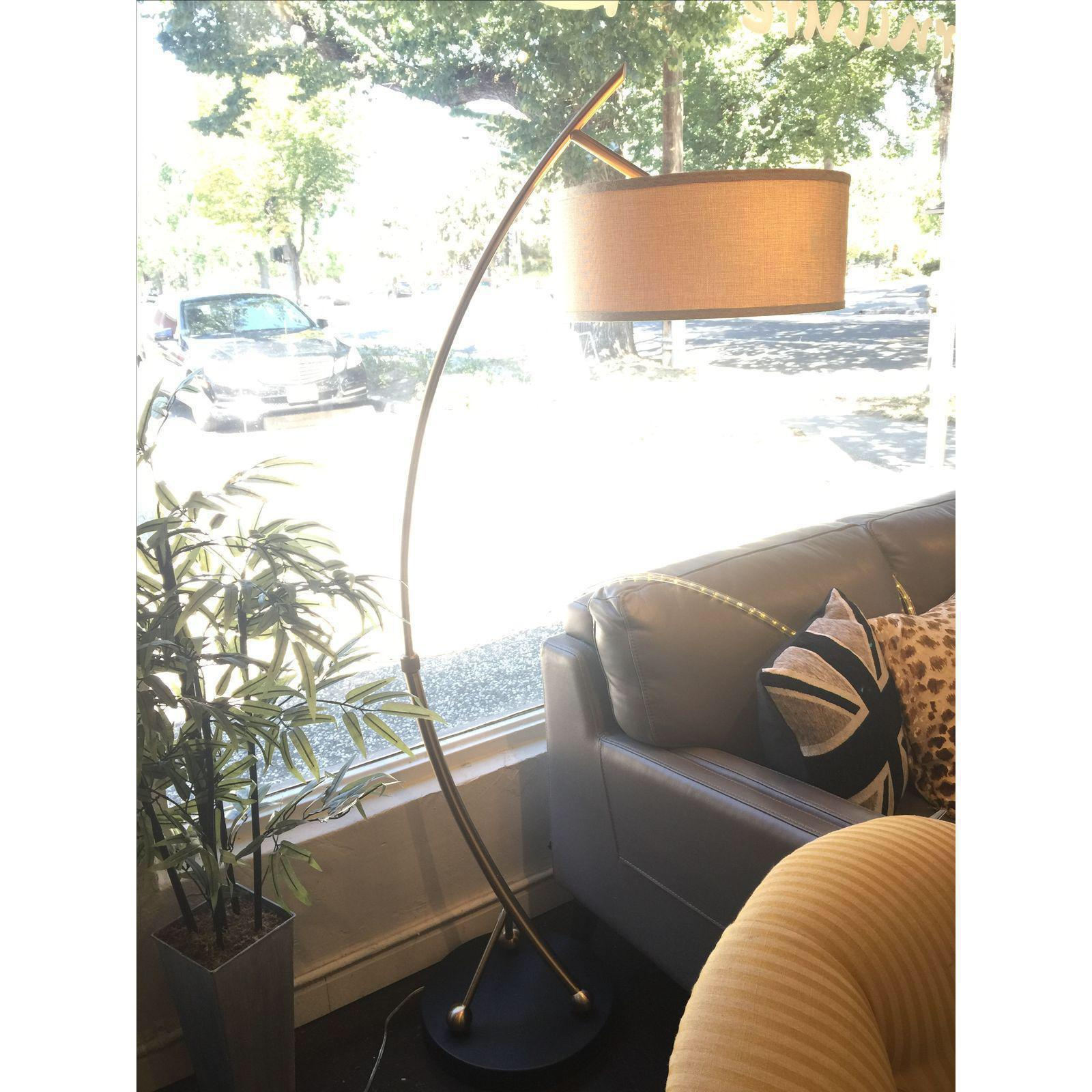 brass arc lamp overarching large and graceful arc lamp the metal is brushed brass the shade features dramatic brushed brass floor lamp chairish
