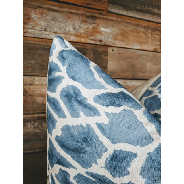 One decorative pillow featuring a giraffe animal print design on home decor weight fabric by Thibaut. For a custom made...