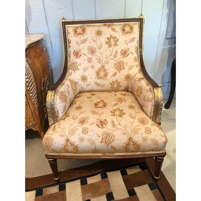 A comfortable beautifully made pair of French style bergère chairs having elaborately carved and gilded wood and pretty...