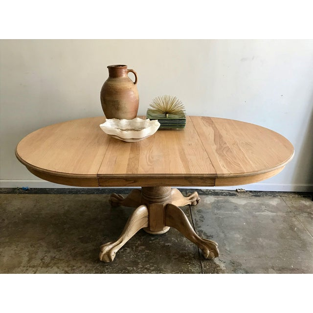 Found on an antiquing trip through California, this Clawfoot dining table is made from 100% Oak. It has recently been...