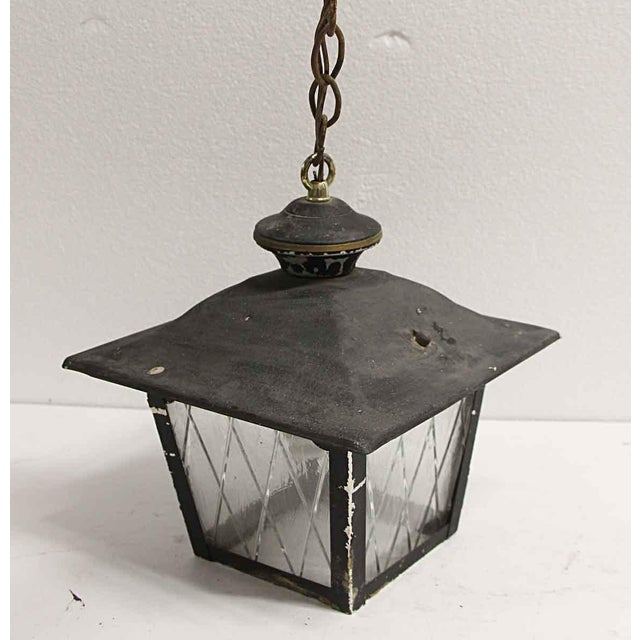 1950s metal lantern with clear crisscross patterned glass and a black finish. Price includes rewiring. The manufacturer is...