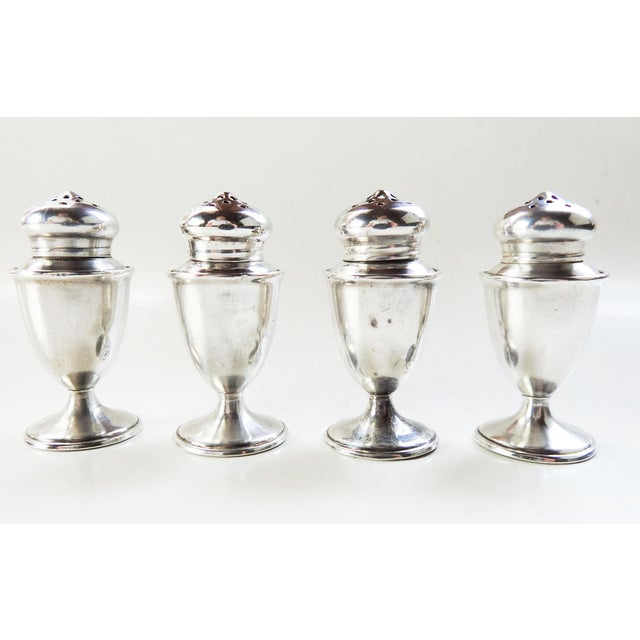 Set of 4 individual sterling silver salt shakers. Circa 1930's marked G. H. French & Co. Screw tops, not wieghted, few...