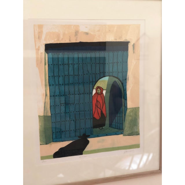 Lovely , moving image of a woman inside a doorway as someone 'returns', by renowned Ecuadorian artist Gilberto Almeida....