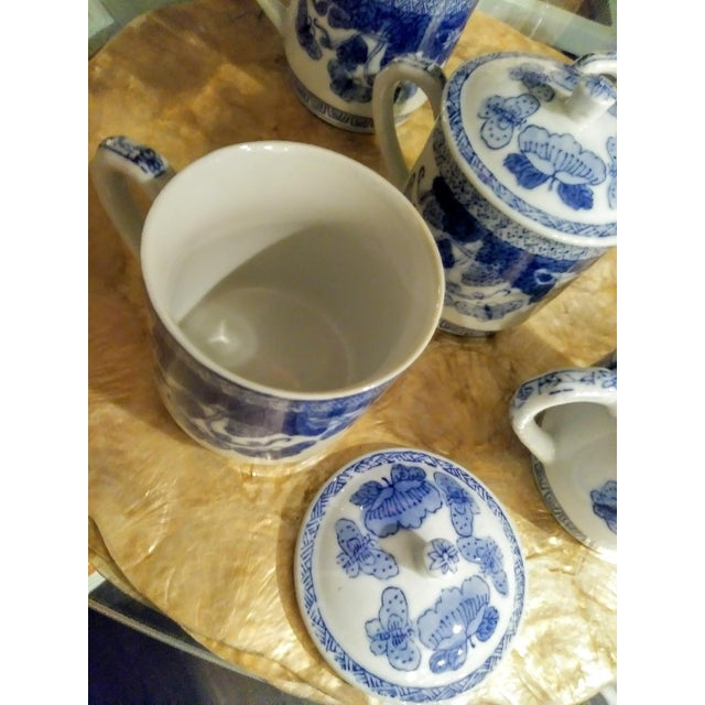 A set of 5 blue and white Chinoiserie ceramic mugs with 5 lids and 5 matching saucers. The mugs are beautiful with a sweet...