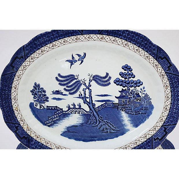 Pair of English platters in Real Old Willow pattern. Maker's mark on underside. Light wear.