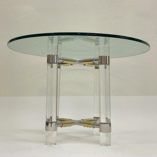 """A rare polish chrome, brass and clear Lucite game table from """"Post Line"""" by renowned American designer Charles Hollis..."""