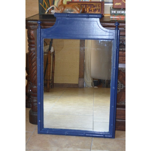 """This is a vintage Henry Link, """"Bali Hai"""" faux bamboo wall mirror. If you adore the Palm Beach Regency look, you will love..."""