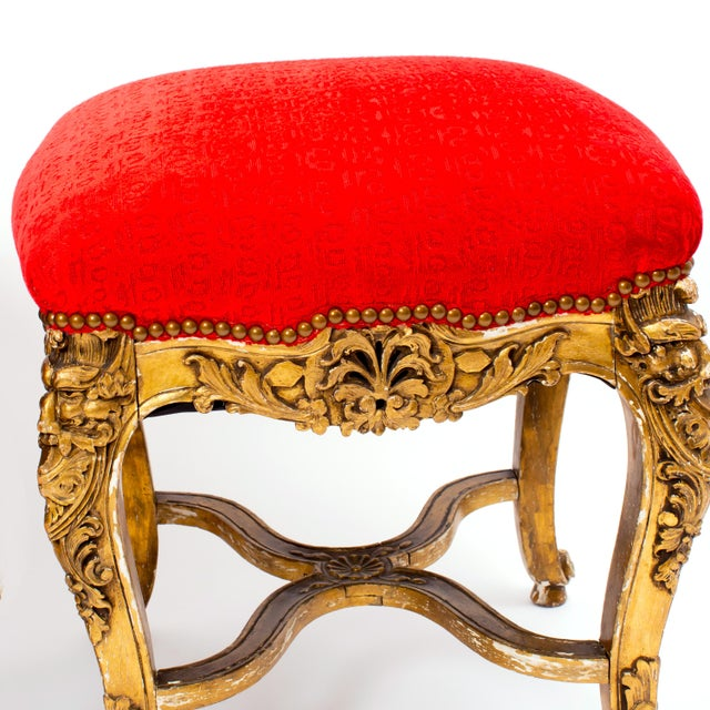 Gorgeous pair of vintage Louis XV Style giltwood tabourets from the early 20th Century. These carved and gilded square...