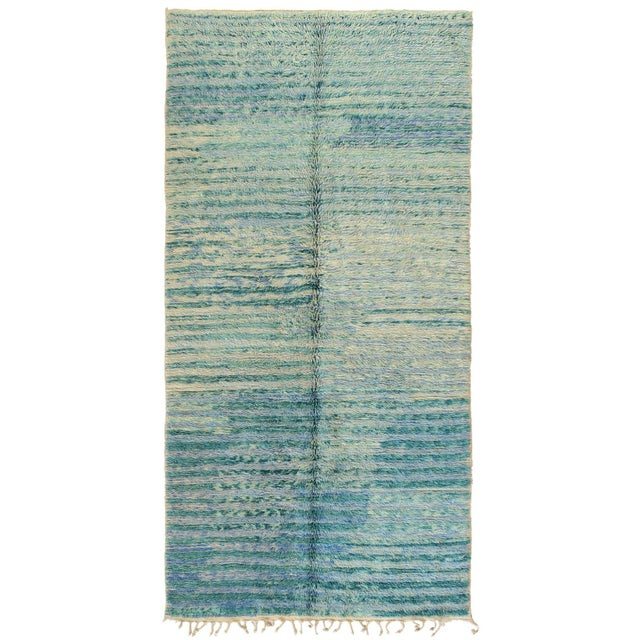 Offered is a vintage Moroccan berber rug. Colors in this piece are a mixture ivory and teal in shag like texture.