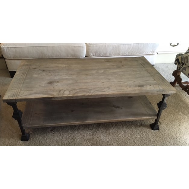 This is a Restoration Hardware Style table. The actual manufacturer is unknown, but it's a good weight, and sturdy. The...