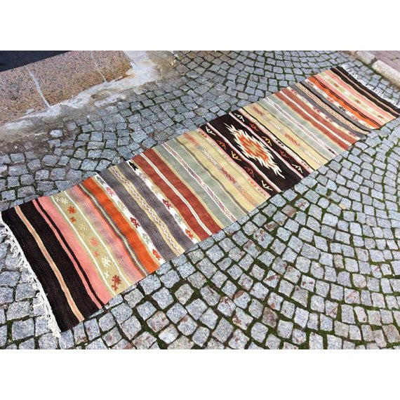 This gorgeous hand knotted vintage Anatolian area rug is approximately 50 years old in excellent vintage condition. The...