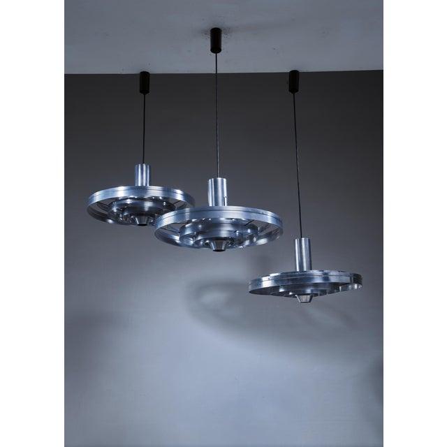 A set of three aluminum Fibonacci pendant lamps, designed in 1963 by Sophus Frandsen for Fog & Mørup, Denmark. It is made...