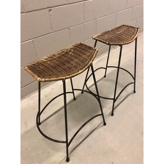 Two vintage Arthur Umanoff counter height bar stools with sculptural wrought iron legs that are painted deep chocolate...