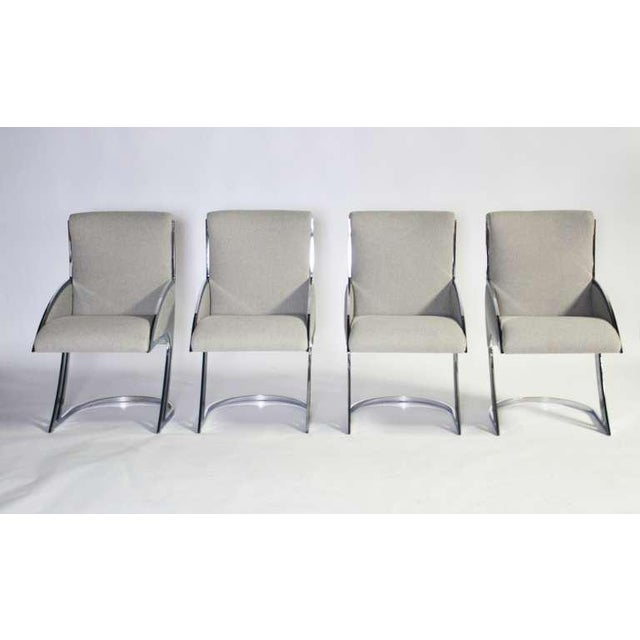 Very rare set of four chrome dining chairs. Newly upholstered in a dove gray Italian synthetic wool. Stunning space age...