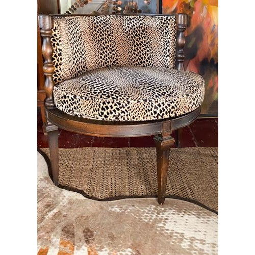 A most fun and fabulous mid century chair in a rounded form. Covered in a low nap leopard or cheetah pattern fabric. It...
