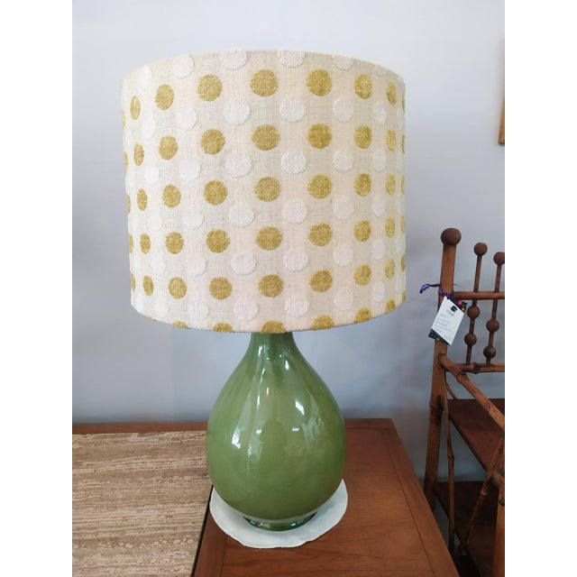 Fun Pair of Mid Century Modern Lamps with shades. The Pair are ceramic with a crackle glaze and topped with a green ball...
