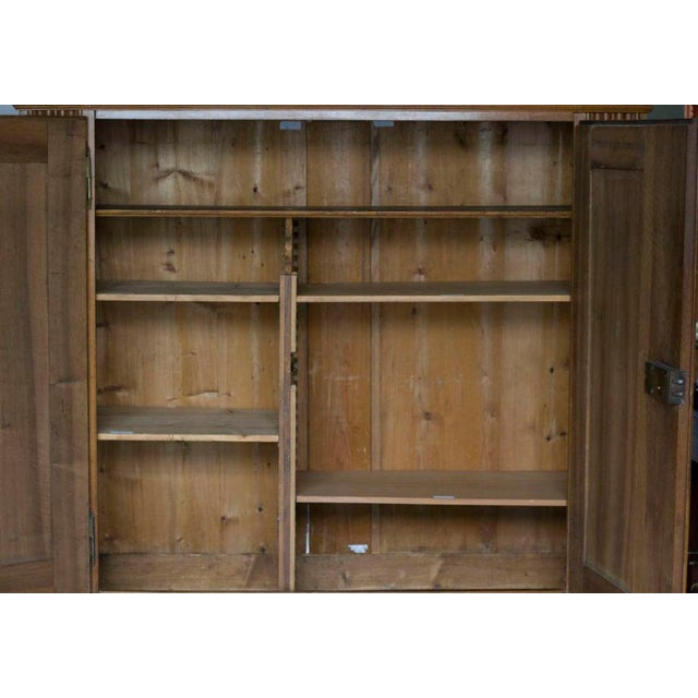 A useful and chic walnut cabinet/armoire. Nice shorter profile with plenty of room for storage and nicely molded paneled...