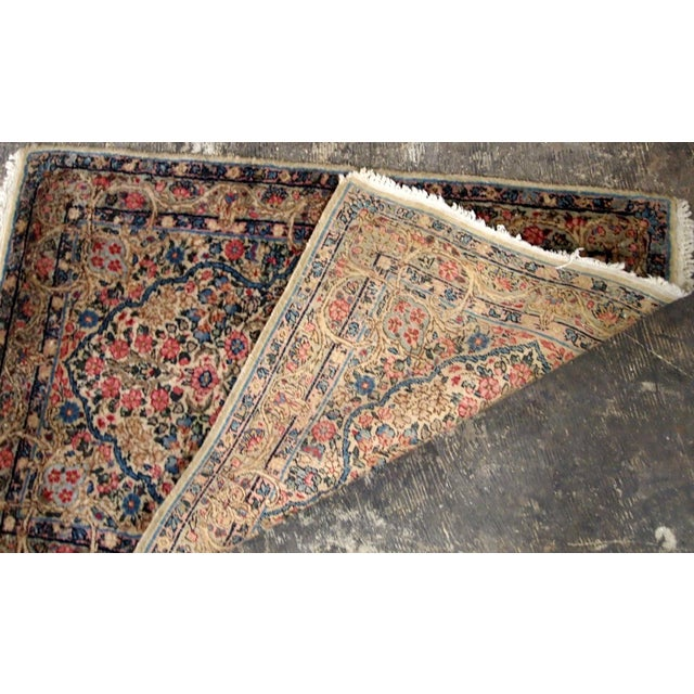 Antique Persian Kerman floral rug in colourful shades. The rug is from the beginning of 20th century in original good...