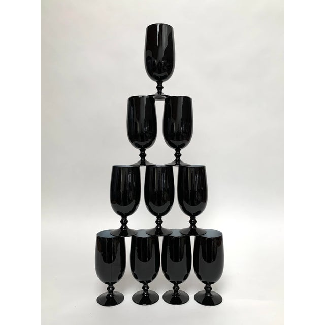 Set of ten black water or cocktail glasses with fused white glass interiors from Italian glass designer and manufacturer...