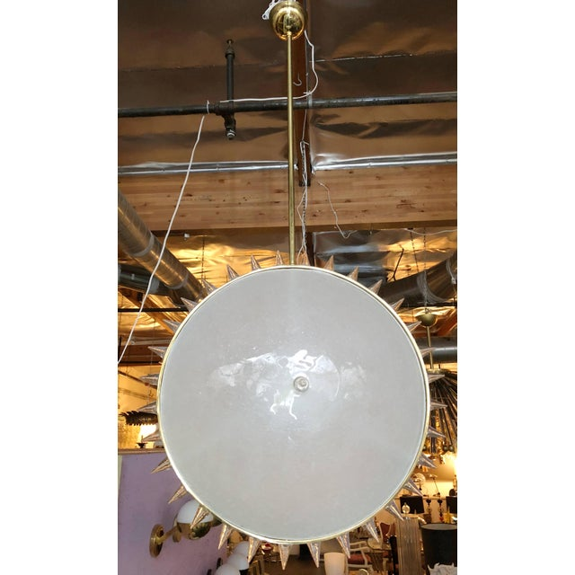 Large Italian Murano glass pendant, composed of 2 round frosted glass shades, with clear glass points mounted on polished...