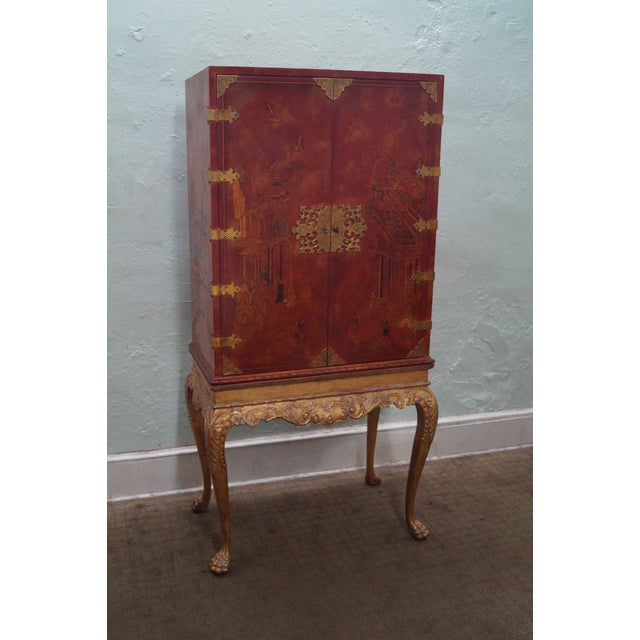 A Maitland Smith hand-painted Chinoiserie cabinet on carved gilded base. It was made 25 years ago in the Philippines. It...