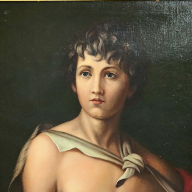 An antique oil on canvas old master portrait painting after Andrea Del Sarto's Saint John The Baptist with crucifix and...