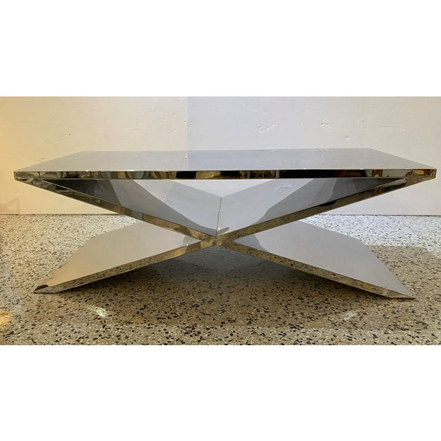 This stylish and substantial x-form cocktail table was acquired from a Palm Beach yacht and thus they are made solid and...