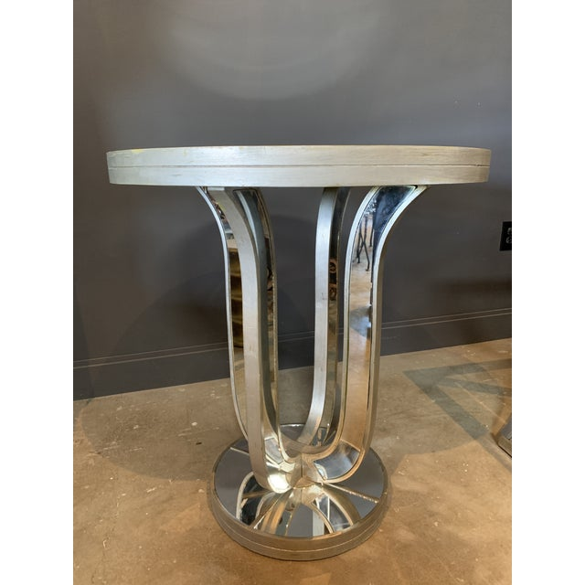 Glamorous, all-around mirrored table with silver in Hollywood Regency style.
