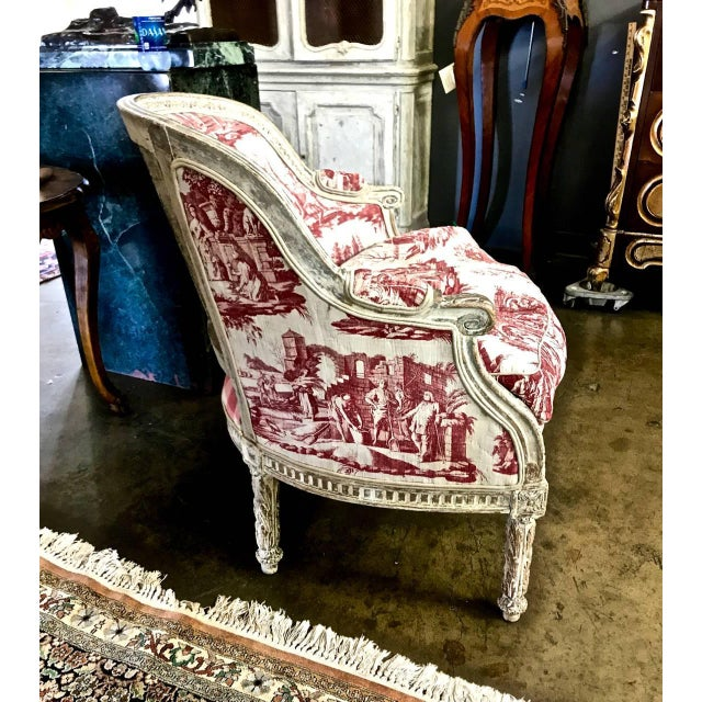 This is a stunning example of a painted period 18th century, Louis XVI bergere. The bergere appears to retain its original...