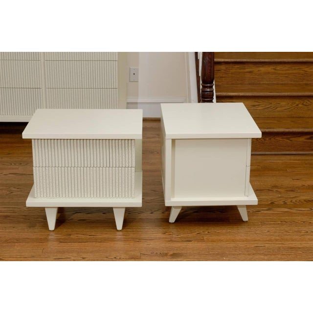 A fabulous pair of end tables or nightstands from a rare series by American of Martinsville, circa 1950. Stout, expertly...