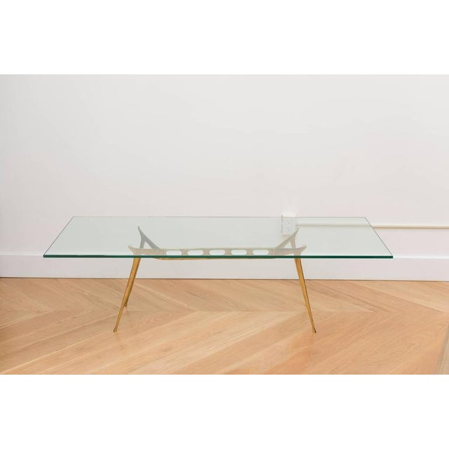 Modernist cast brass Italian cocktail table.