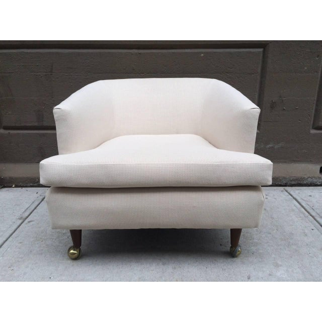 Pair of Kipp Stewart for Directional lounge chairs. Upholstered in linen. Legs are wood with casters.