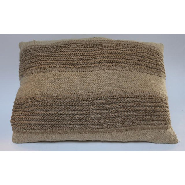 Jute pillows with decorative stripes Dimensions: Rectangular with white stitching 22'' x 33'' - $1250 Rectangular crochet...