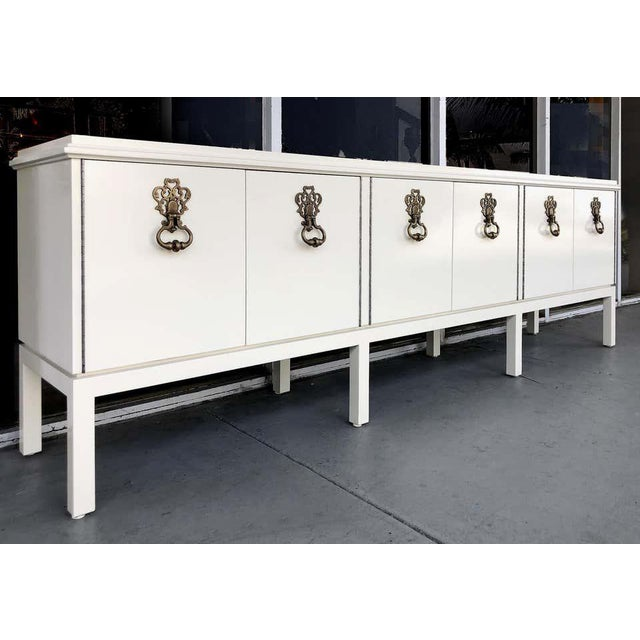 Offered for sale is a fabulous overscale Hollywood Regency style credenza from Mastercraft that has been created in the...