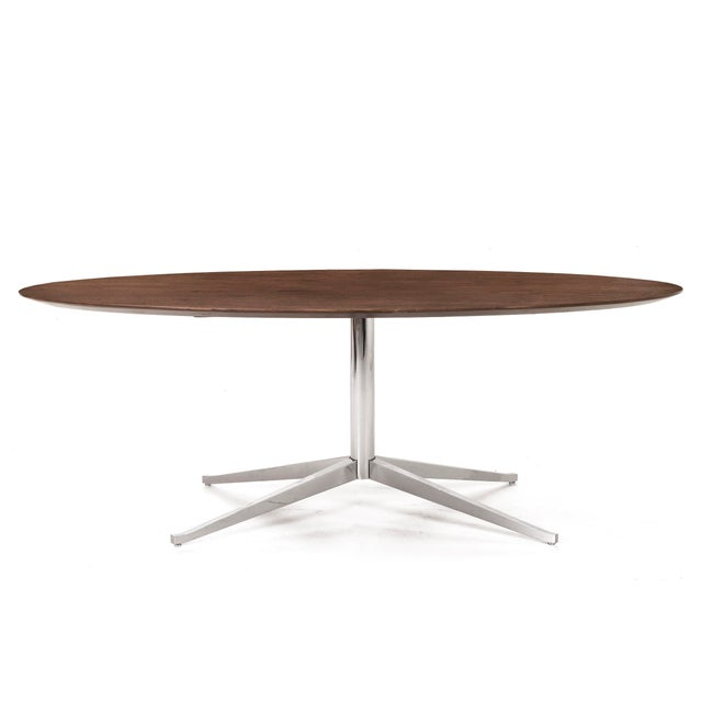 Florence Knoll for Knoll pedestal table. Solid walnut top on a chrome-plated steel base. Can be used as a dining table or...