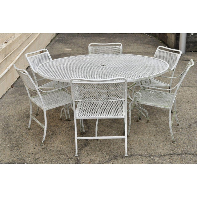 Hollywood Regency Late 20th Century Vintage Cast Aluminum Scroll Arm Metal Patio Dining Table & Chairs - Set of 7 For Sale - Image 3 of 13