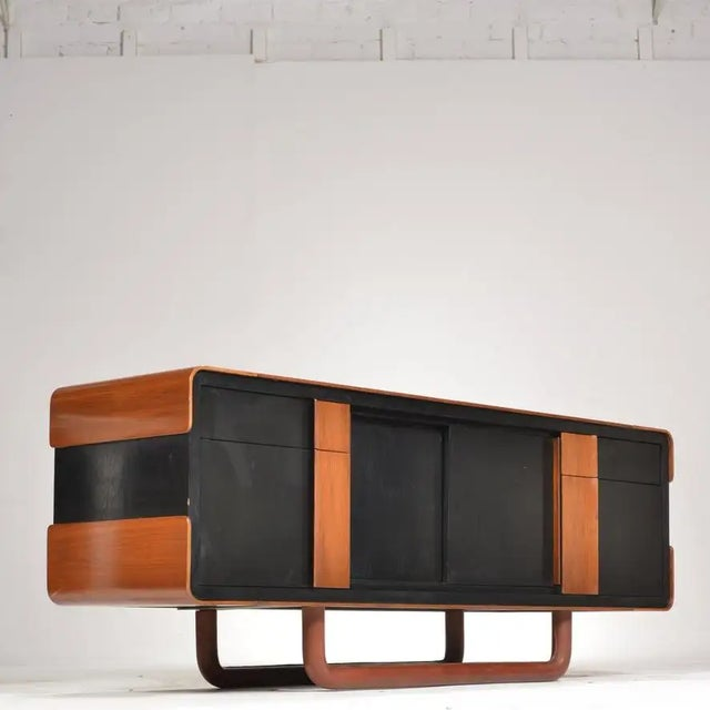 Unique, modern Italian credenza or media cabinet with sliding doors, lacquered finish, and leather base.