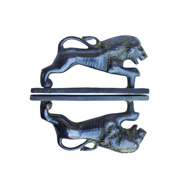 A pair of green brass lion door handles or cabinet pulls. Hollywood Regency in style, with intricate carving throughout....