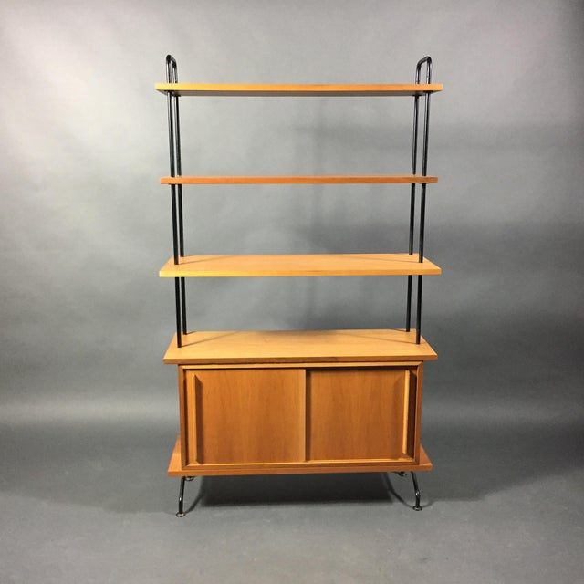 The diminutive size of this standing shelf is perfect for smaller space needs. Manufactured in Switzerland in the 1950s,...