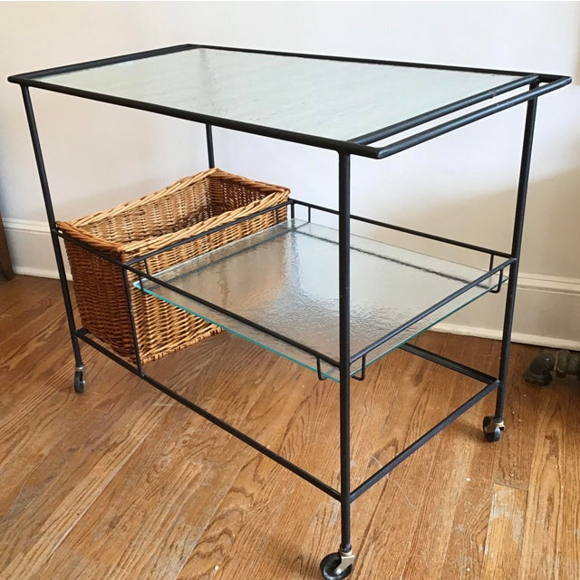 Mid Century 1960's bar cart with original wicker basket designed by Paul McCobb. Rarely seen form, perfect for indoor or...