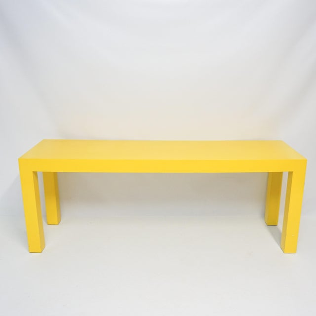 Bold vintage Parsonsntable made of wood with painted finish in bright gleaming original yellow. Very good condition, light...
