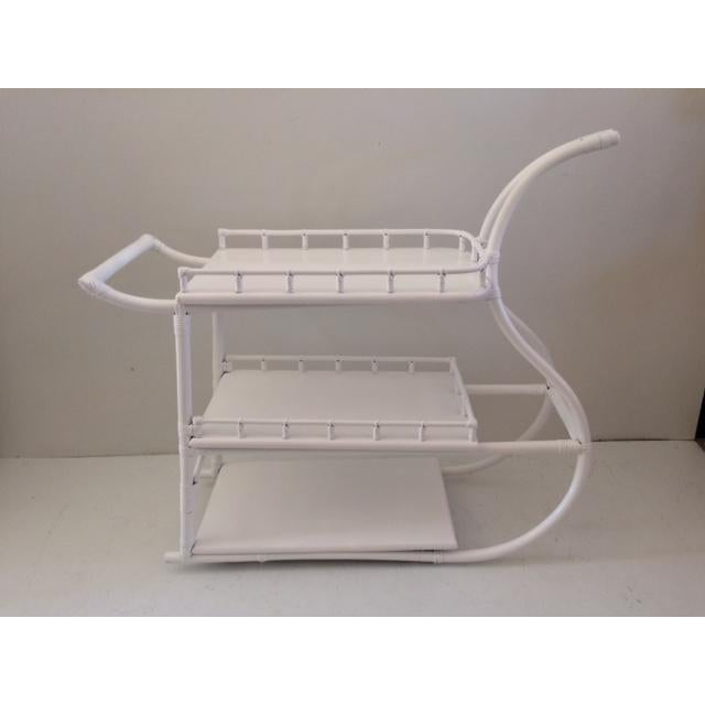 White rattan regency bar cart. Made in the 1970s.