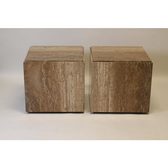 Pair of 1970s cube travertine side tables on casters. Designed in the style of Willie Rizzo, these minimally appointed...