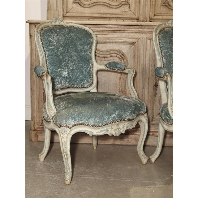 This is a wonderful pair of rare French blue and cream colored cabriolet chairs from the mid 1700s. The are completely...