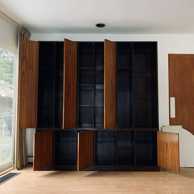 Impressive 1960s Harvey Probber wall unit/cabinet with 6 doors and wooden shelves. Exposed shelves are glass for displays....