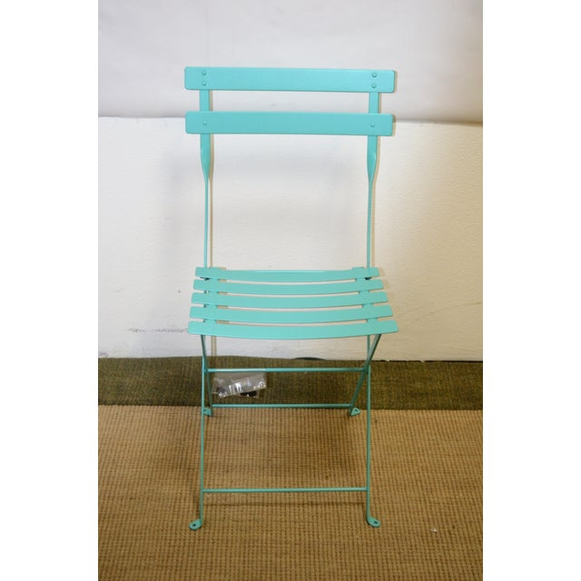 Fermob's folding Bistro furniture is not only charming and convenient, but weather-proof, too – the anti-UV powder coating...