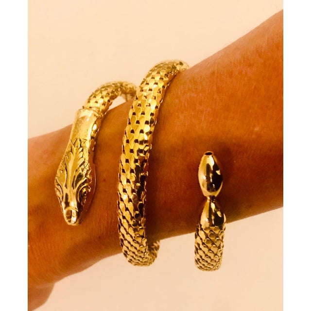 Circa 1940s Victorian Revival gold mesh serpent bracelet. Constructed of quality gold plated metal with beautifully...