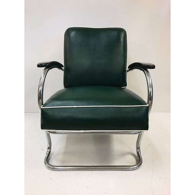 Pair of KEM Weber for Lloyd Tubular Chrome Lounge Chairs. Chairs are vinyl with a steel frame. Chairs have original fabric...