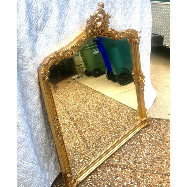 This Beautiful Antique Gold Gilt Beveled Mirror is a thing of beauty. In excellent shape it would look wonderful over a...